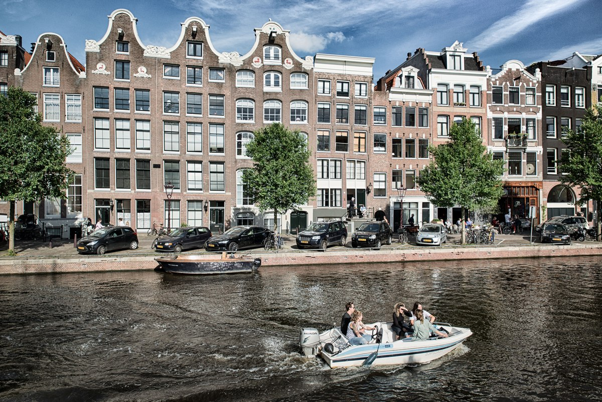Motor boat moving on an Amsterdam canal