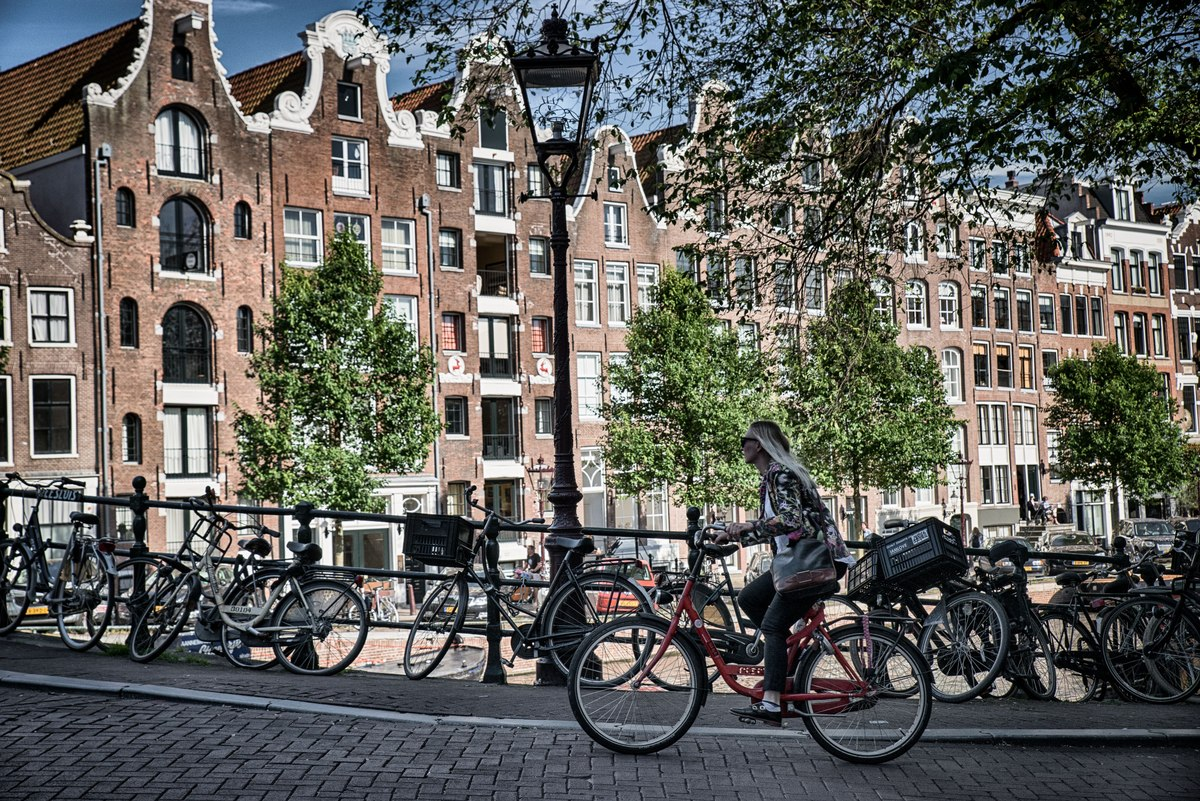 Woman riding bike in Amsterdam