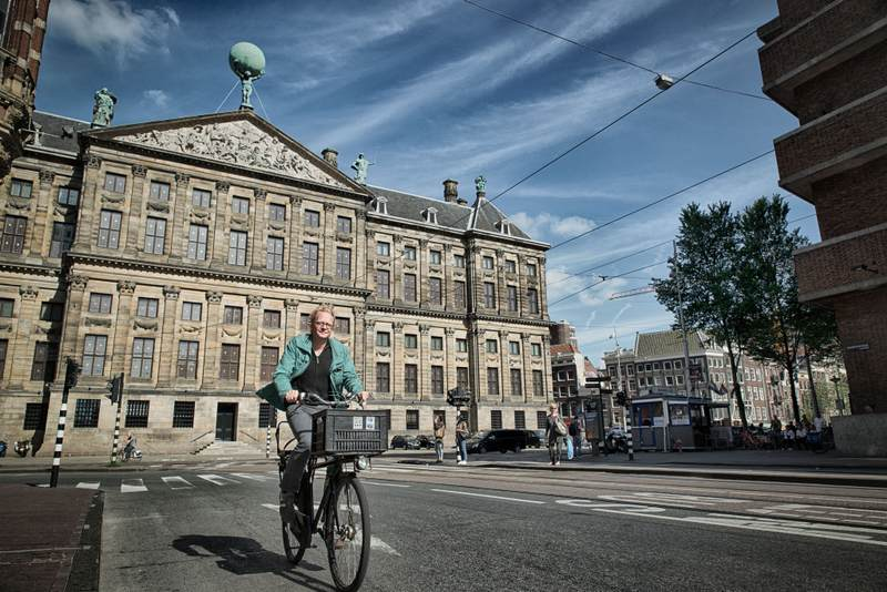Man riding bike in Amsterdam