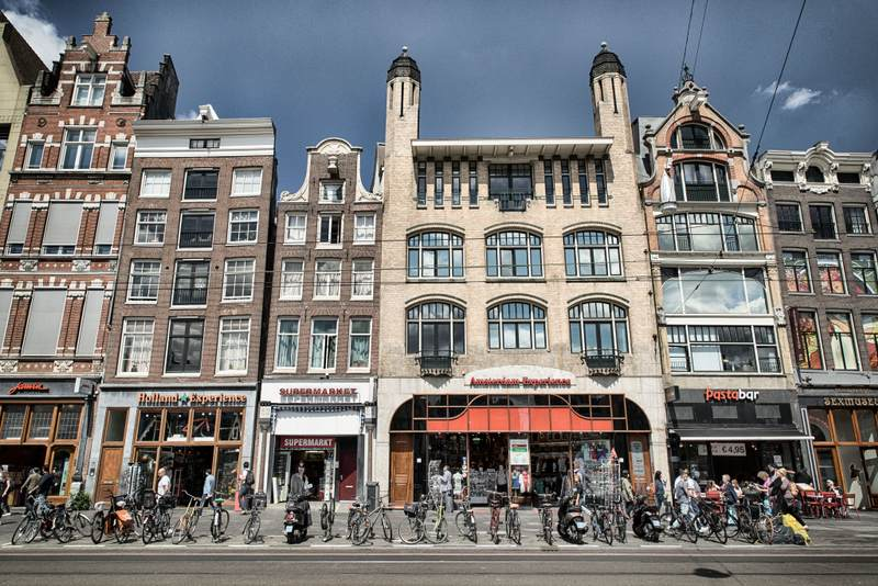 Amsterdam building with bikes in front