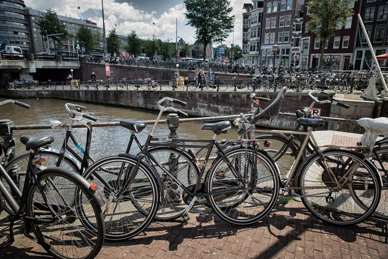 Bikes parked near Amsterdam canal